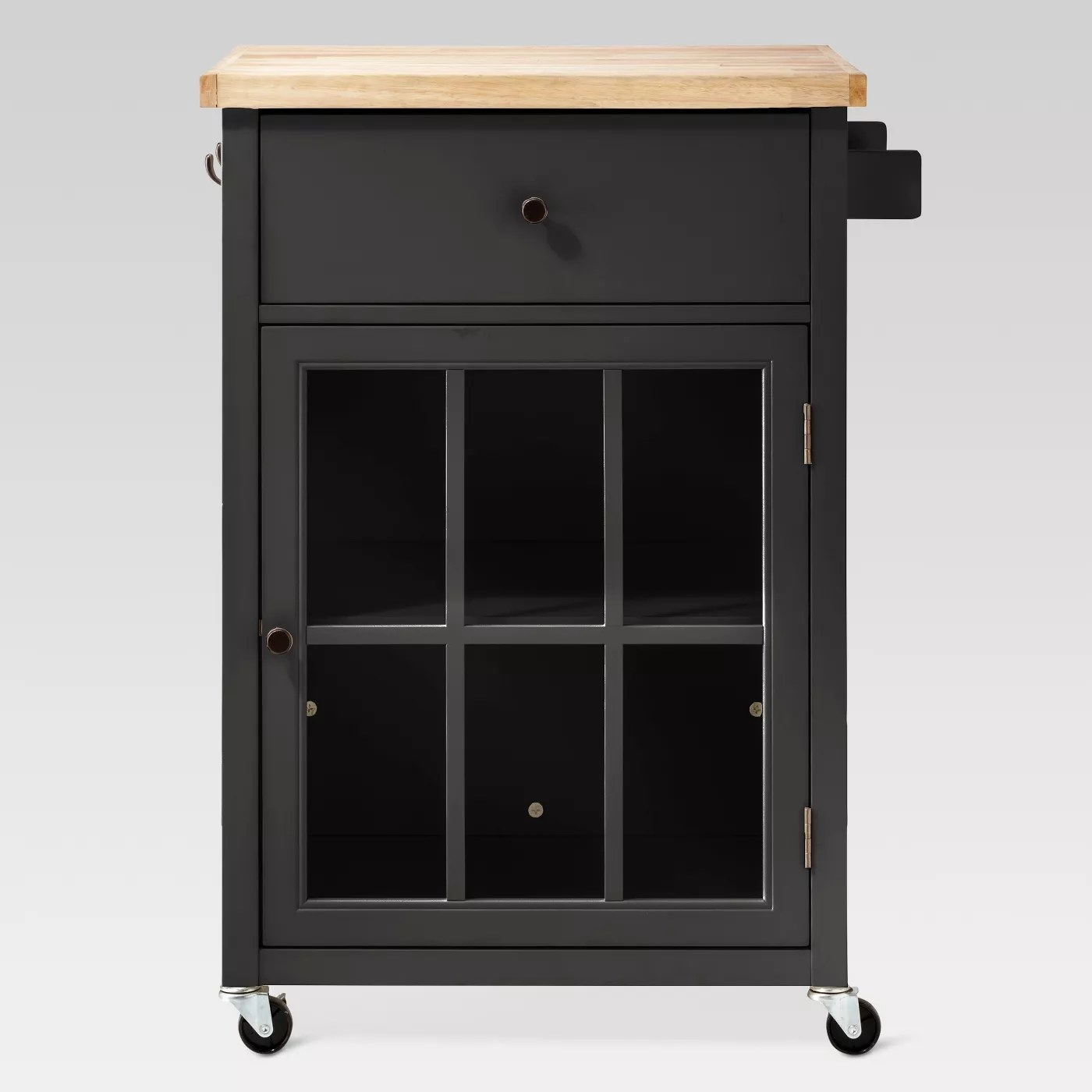 The black kitchen cart with a windowed cabinet door and casters