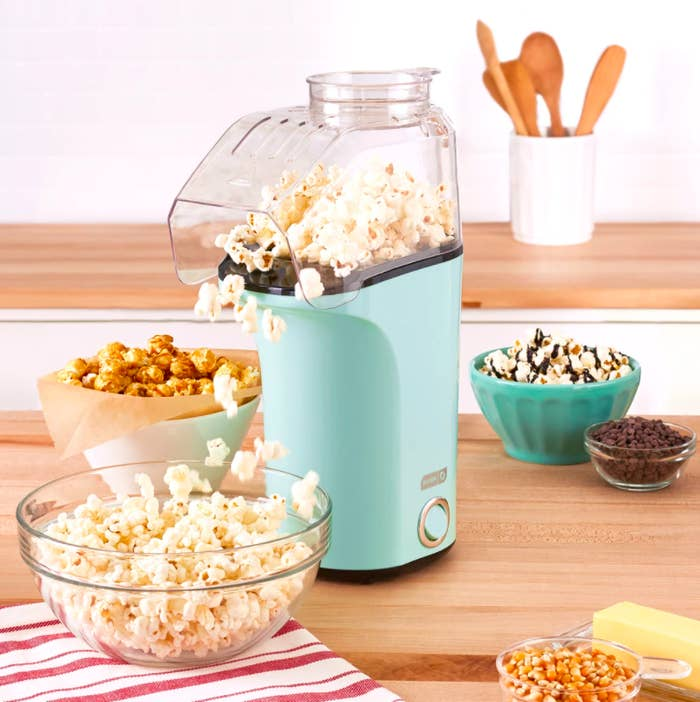 The popper making a bowl of popcorn