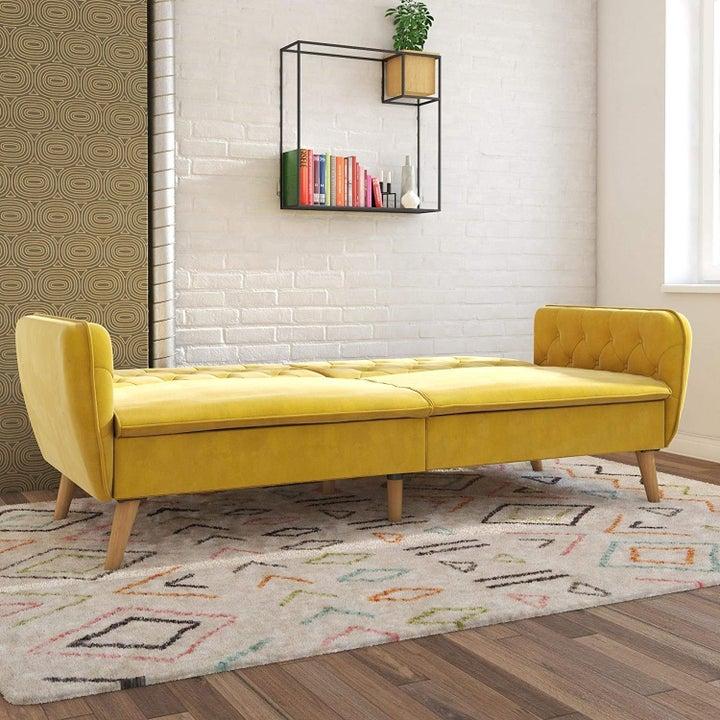 the yellow futon unfolded to create a mattress