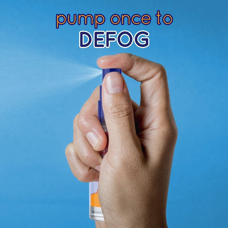 A hand spraying the anti-fog spray