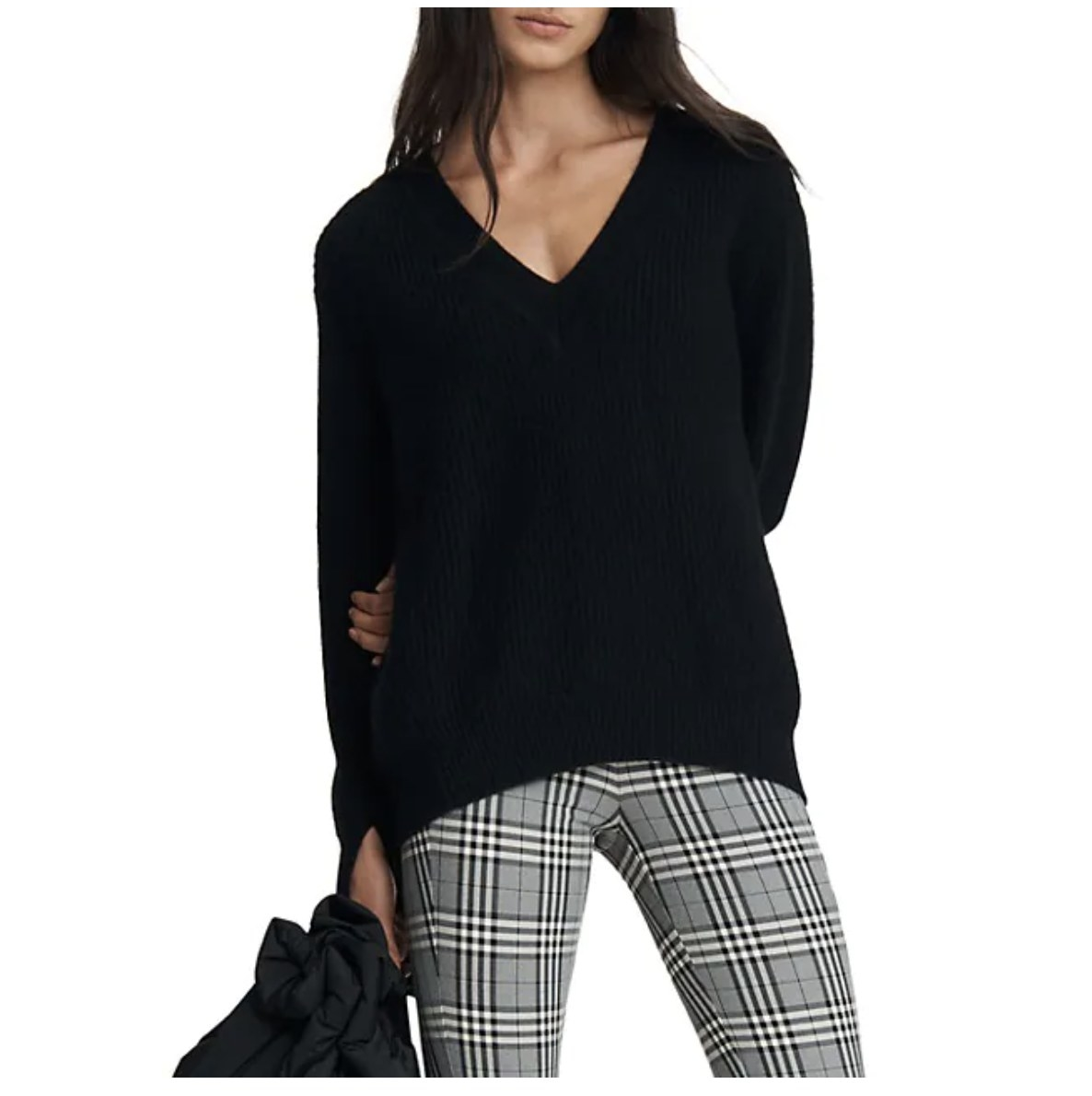 the sweater in black on a model with plaid pants