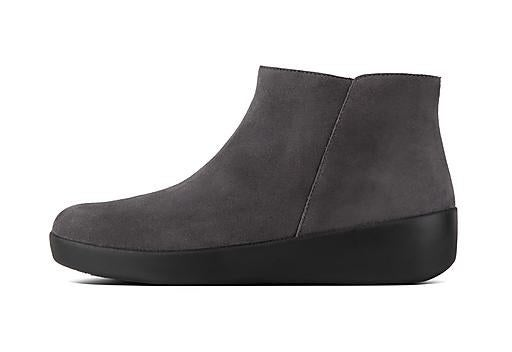 The boot, which has a sloping rubber sole and suede upper, in gray