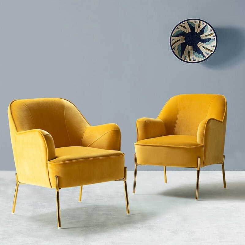 The set of two armchairs in mustard yellow