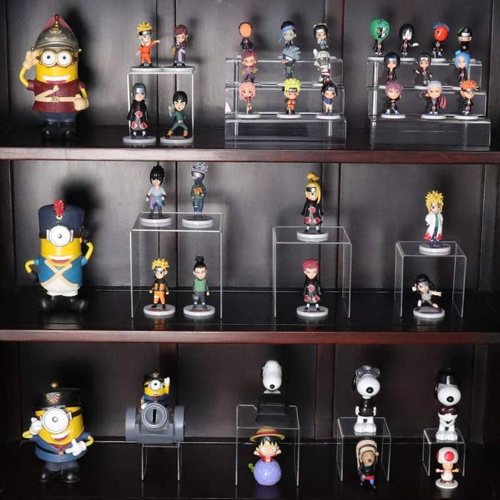 figurines displayed on acrylic stands