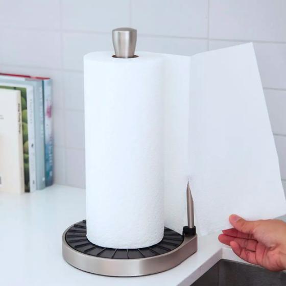 Someone tearing away a single sheet of paper towel