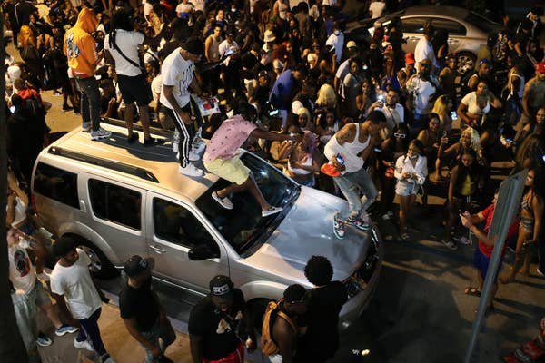 people standing on a car