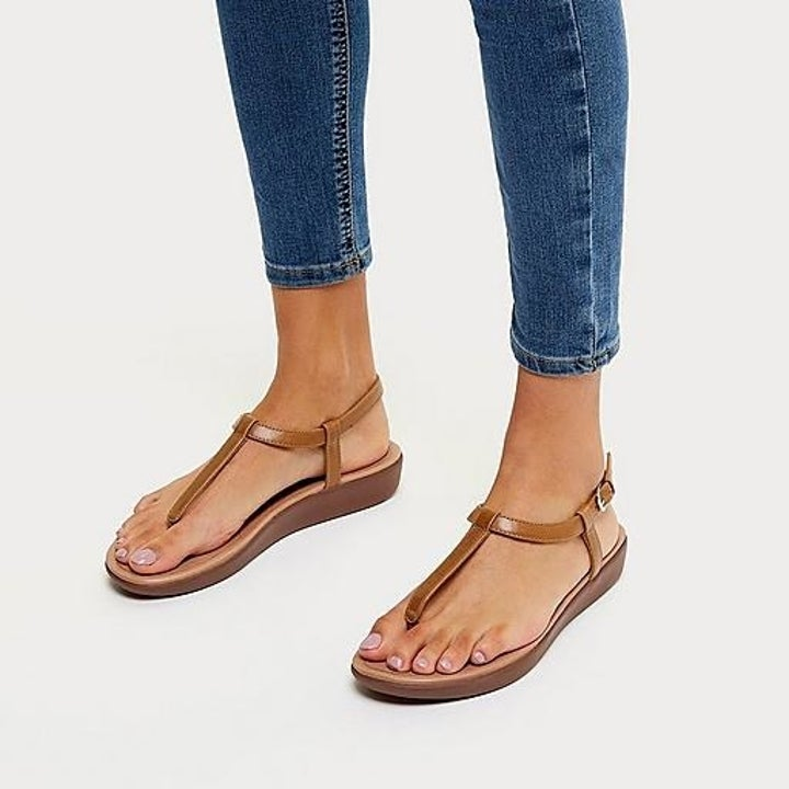 The sandal, which buckles in a circle around the ankle, and then has thin straps on either side of the ankle and down through the toe