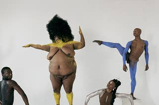 five naked dancers with their bodies painted in a white room, posing for the camera
