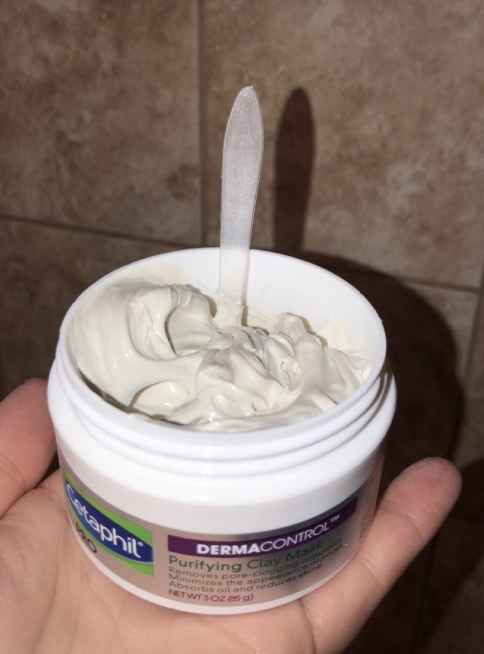 a clay mask with a spatula in it