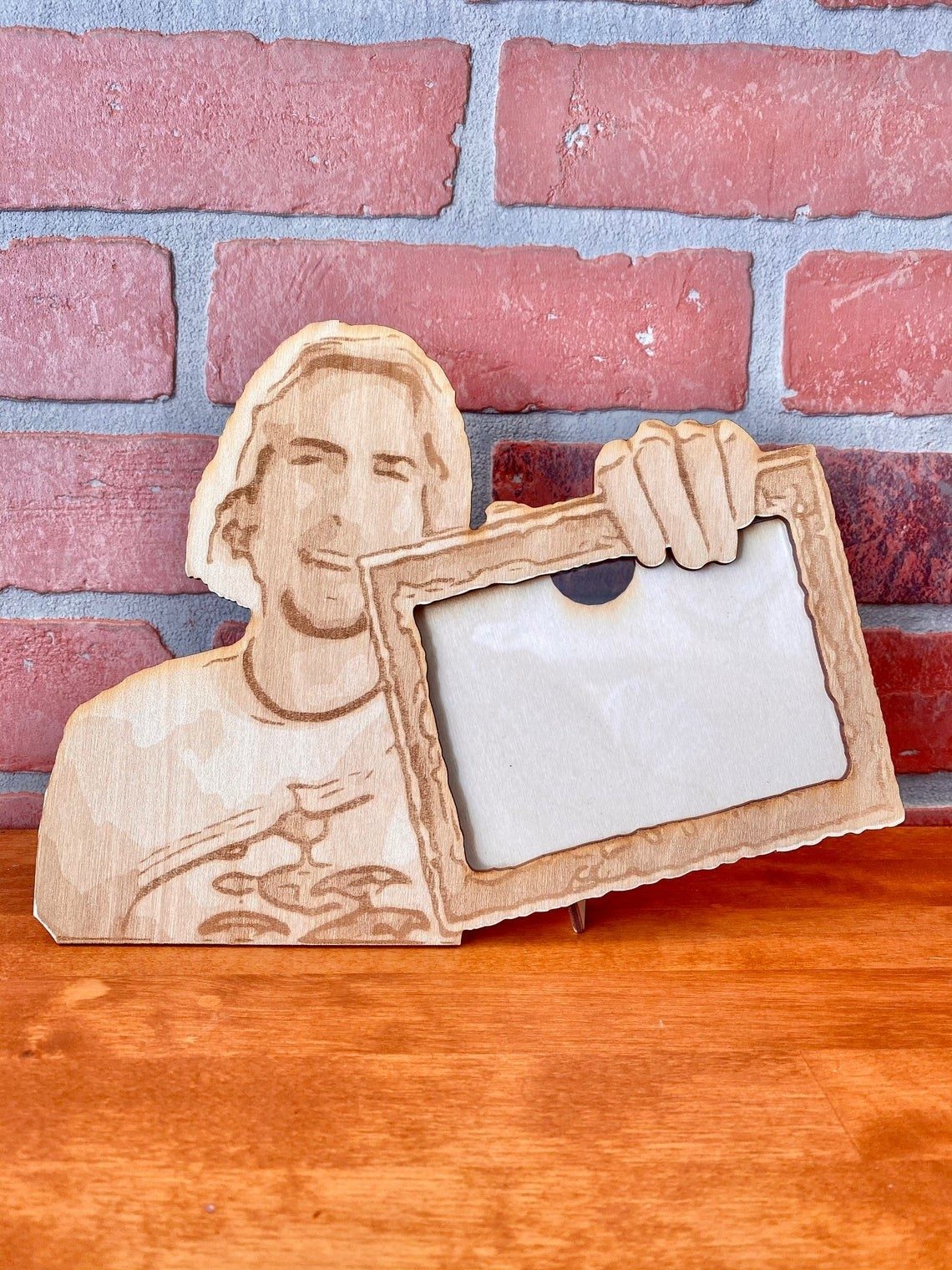 wood frame shaped like the meme of nickelback singer saying look at this photograph