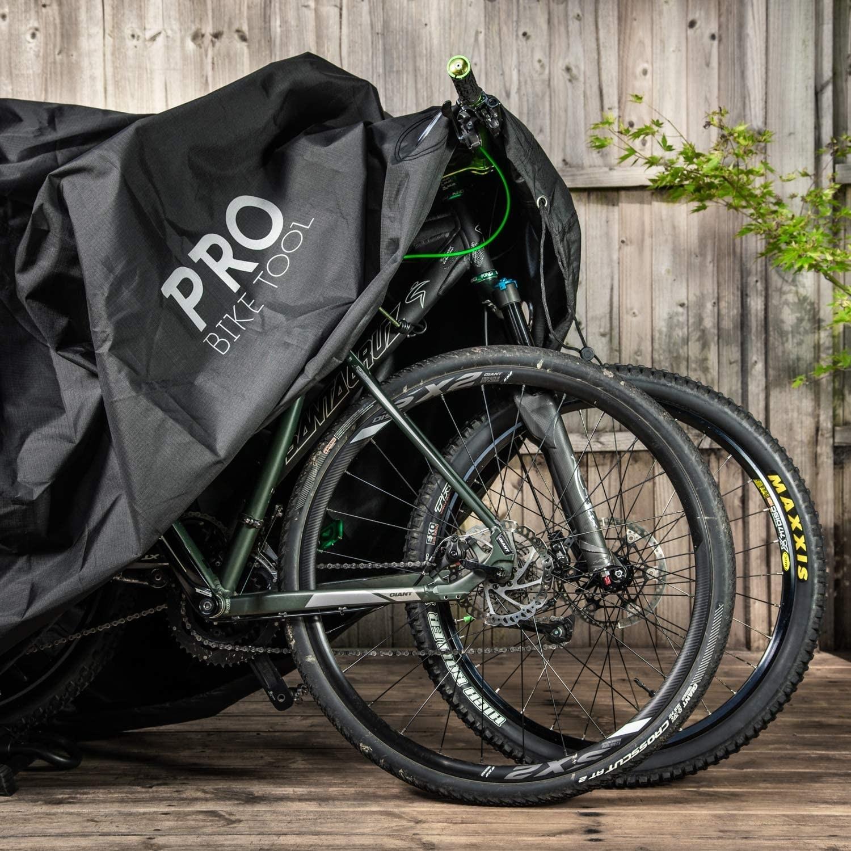 Two bikes underneath the bike cover