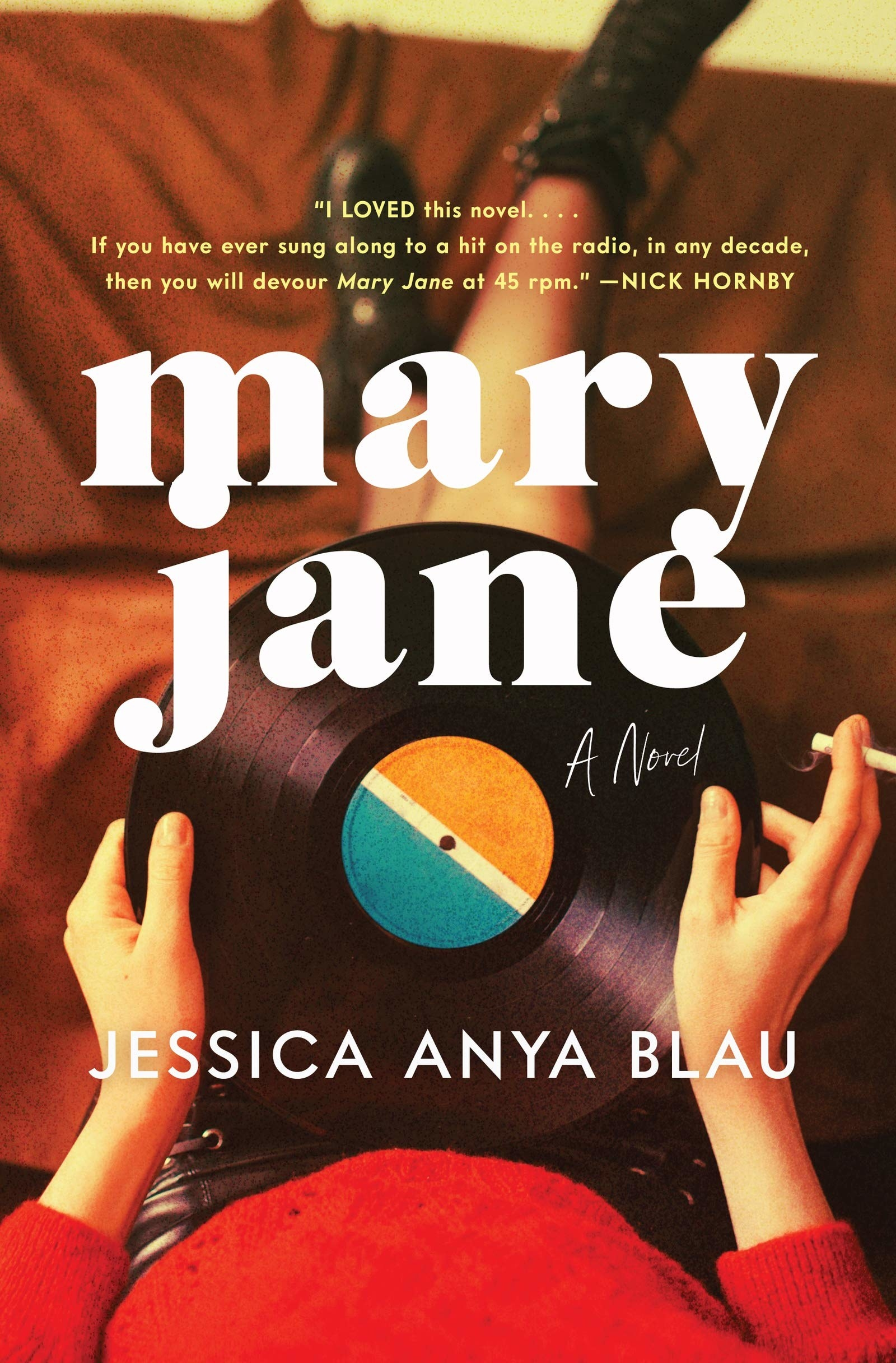 the book cover with person holding a vinyl record