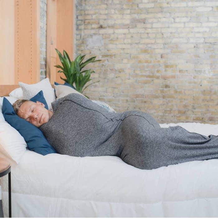 a model sleeping in the sleep pod