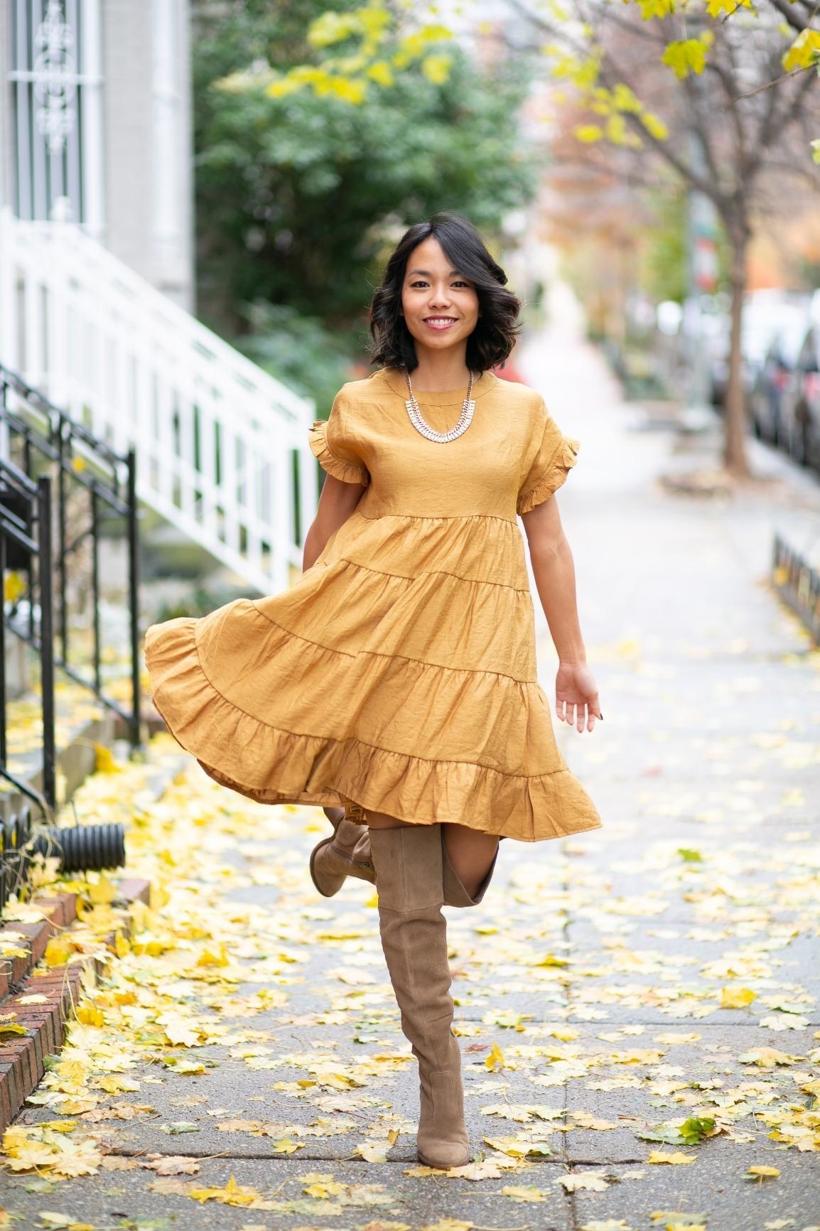 a reviewer photo of the ruffle dress in mustard yellow