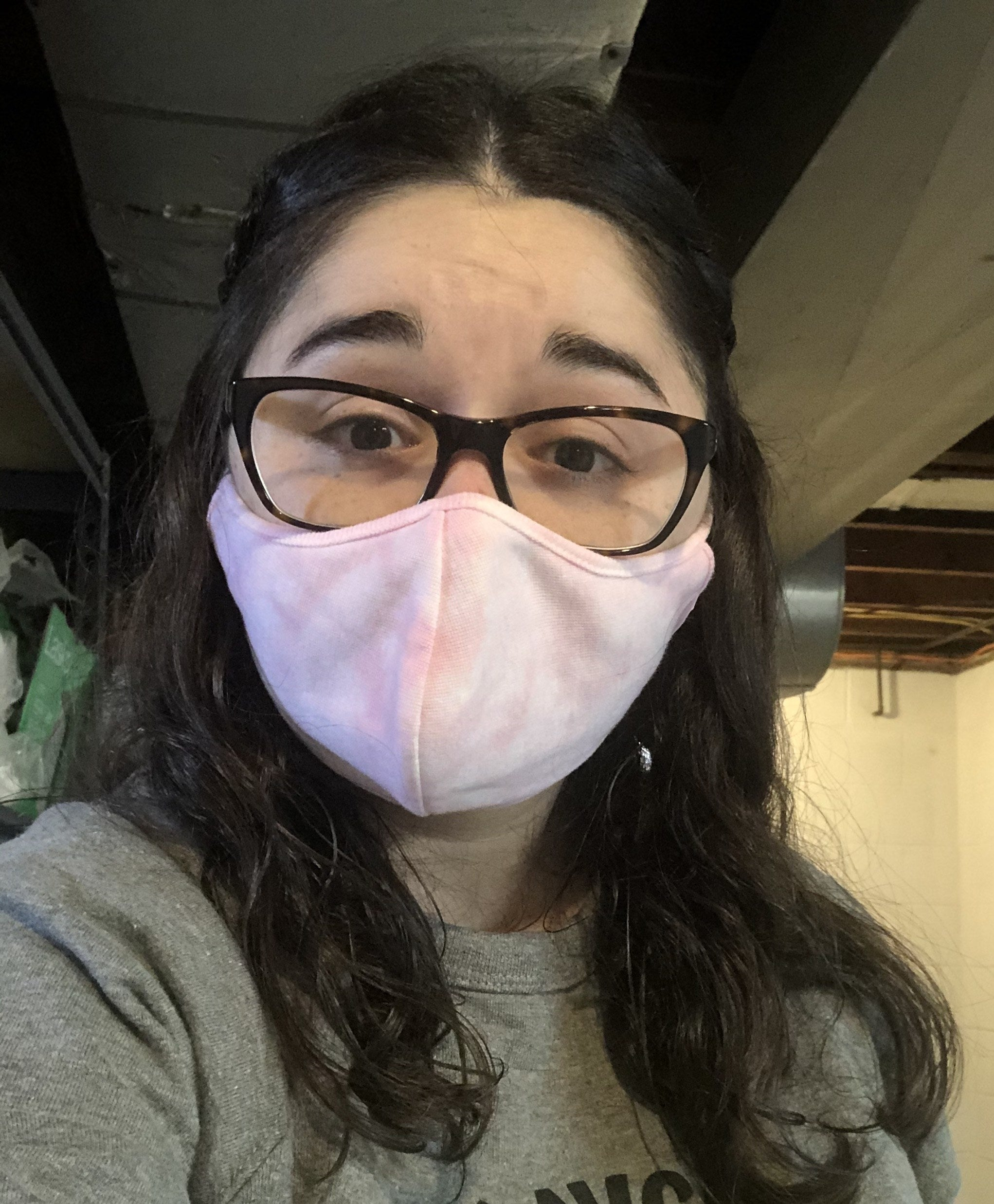 buzzfeed editor in a pink and white tie-dye face mask