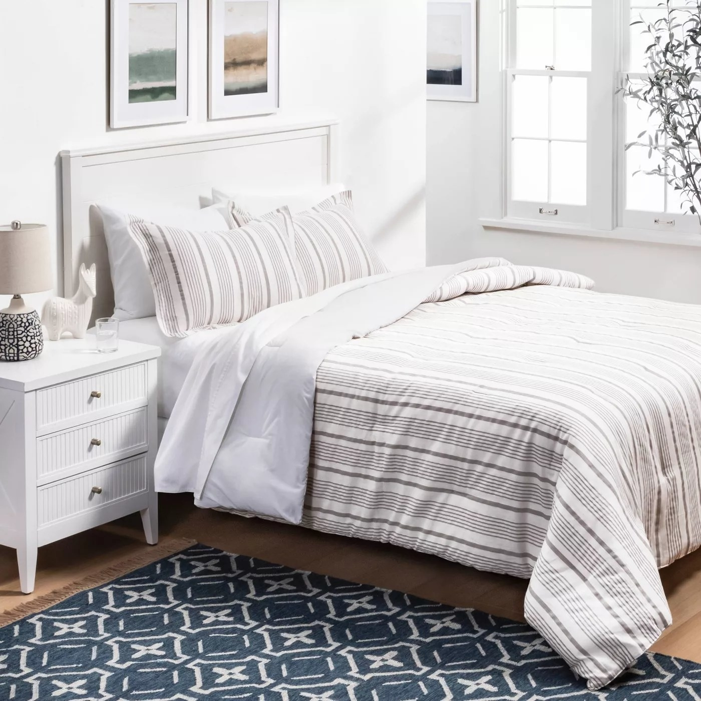 The white and gray comforter and shams