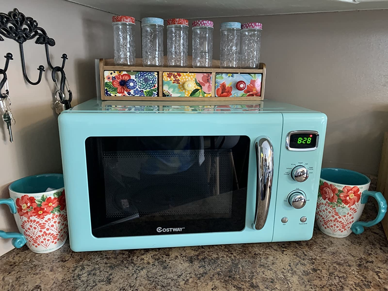 reviewer image of the green COSTWAY Retro Countertop Microwave on a kitchen counter