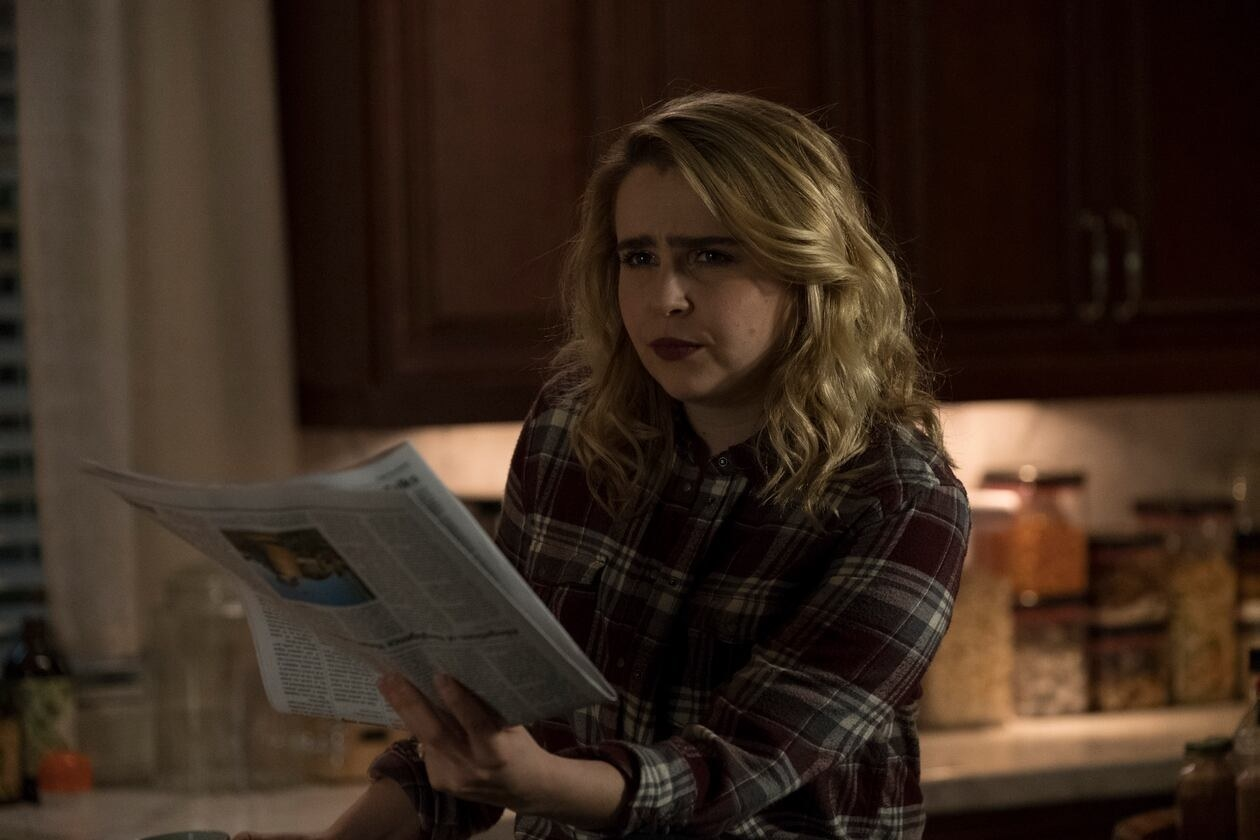 Mae Whitman as Annie Marks standing in a kitchen holding a newspaper
