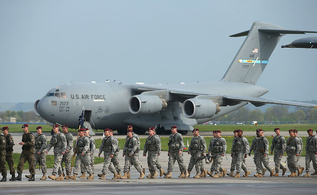 a military group boarding a plane