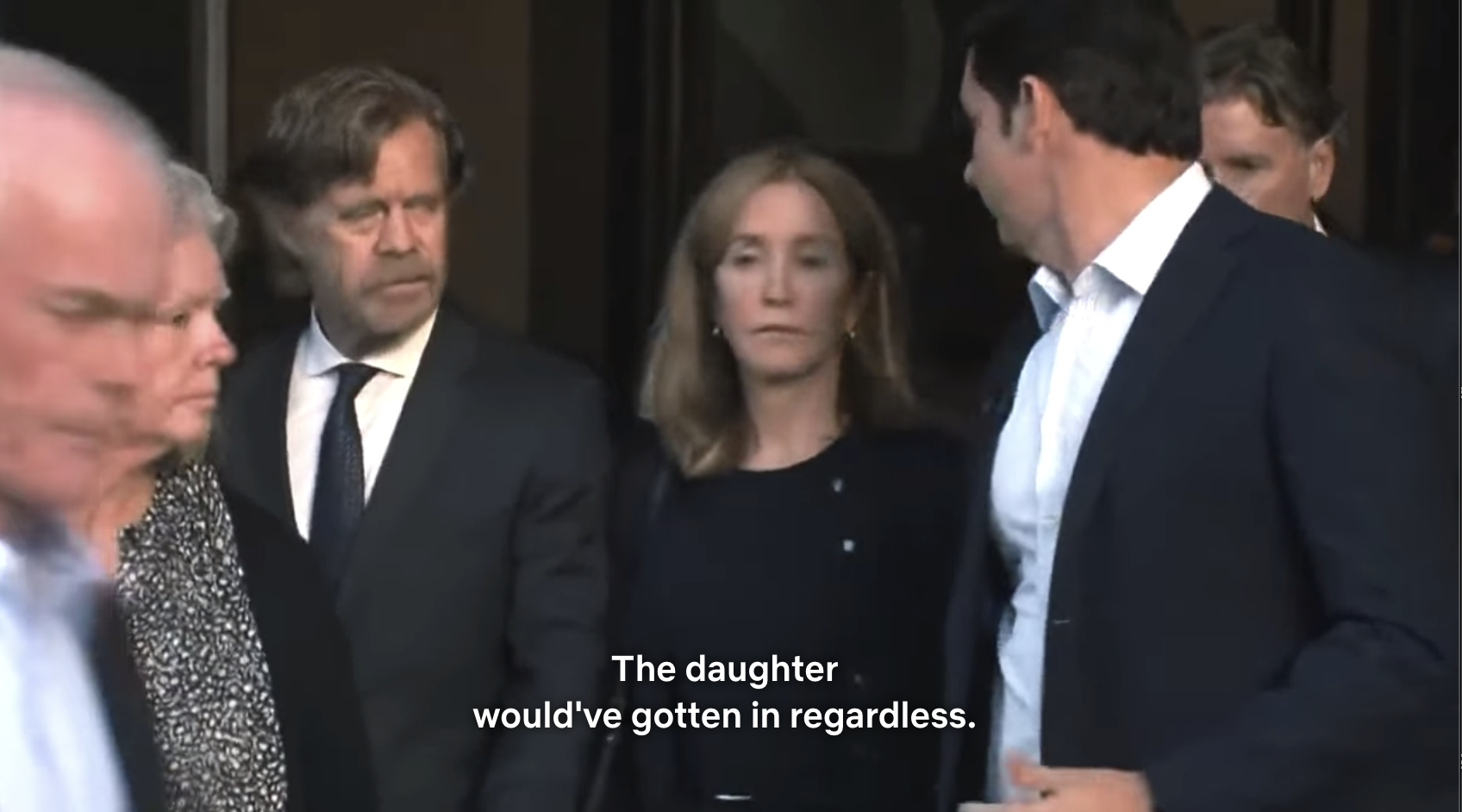 Felicity Huffman and William H. Macy leaving the courtroom