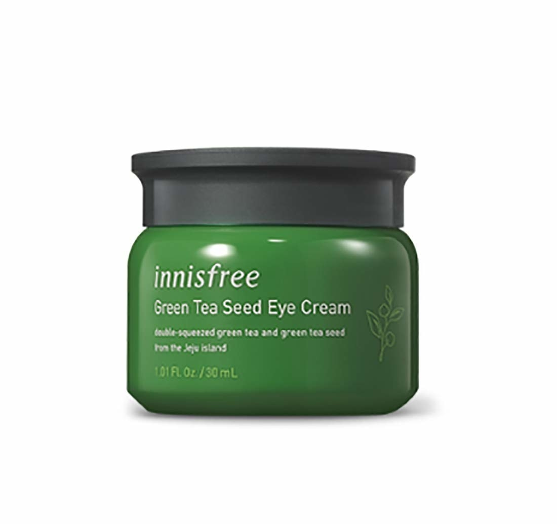 the eye cream in its green jar