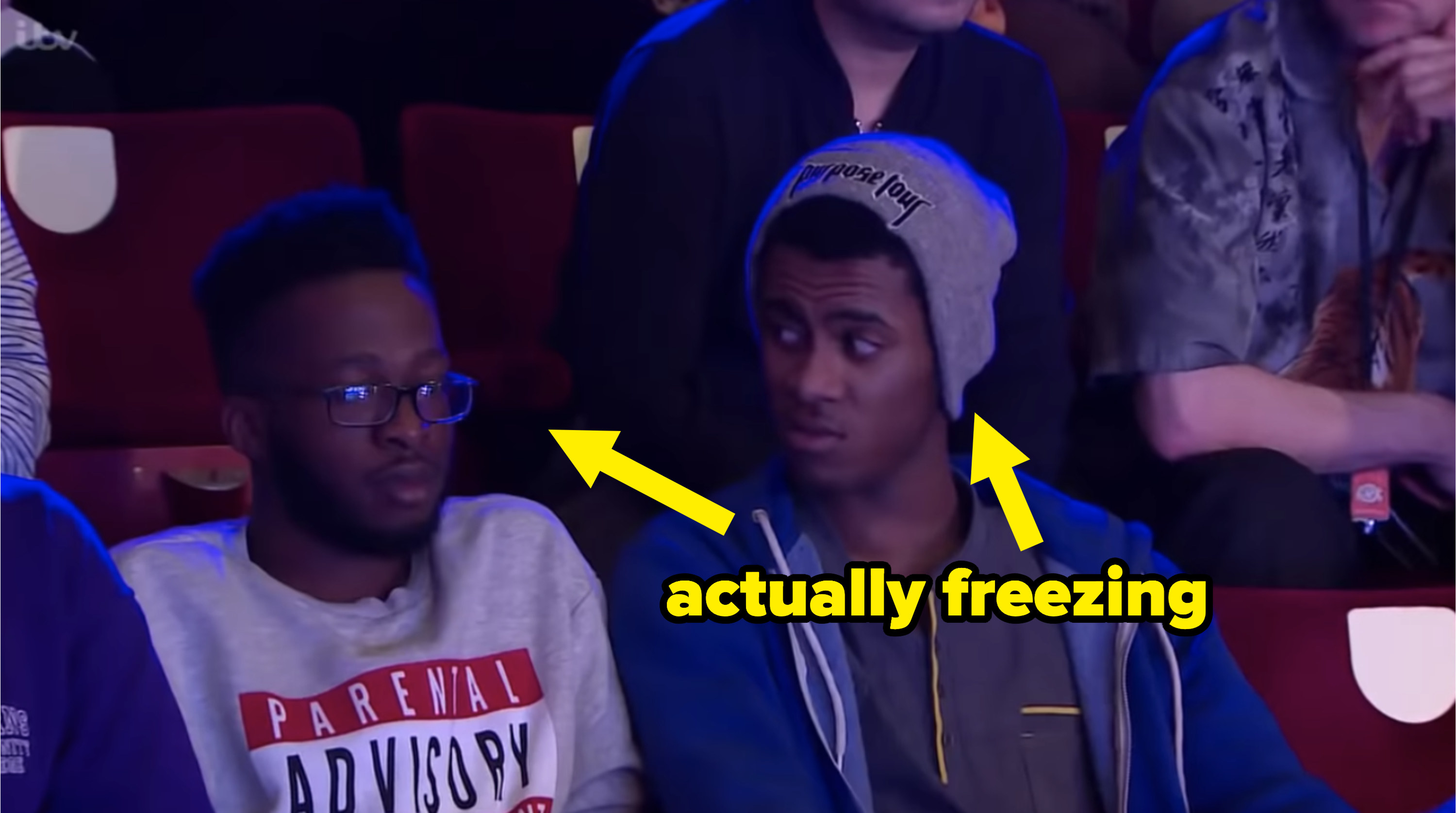 "two audience members with an arrow pointing to them that says, ""actually freezing"""