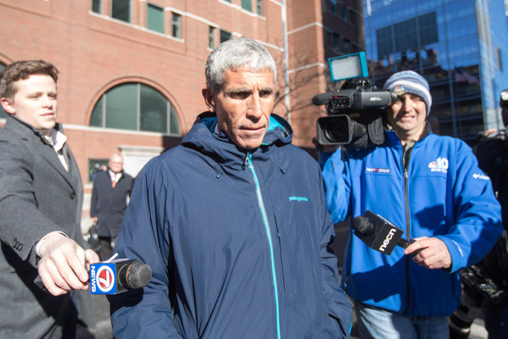 Rick Singer leaves Boston Federal Court after being charged with racketeering conspiracy