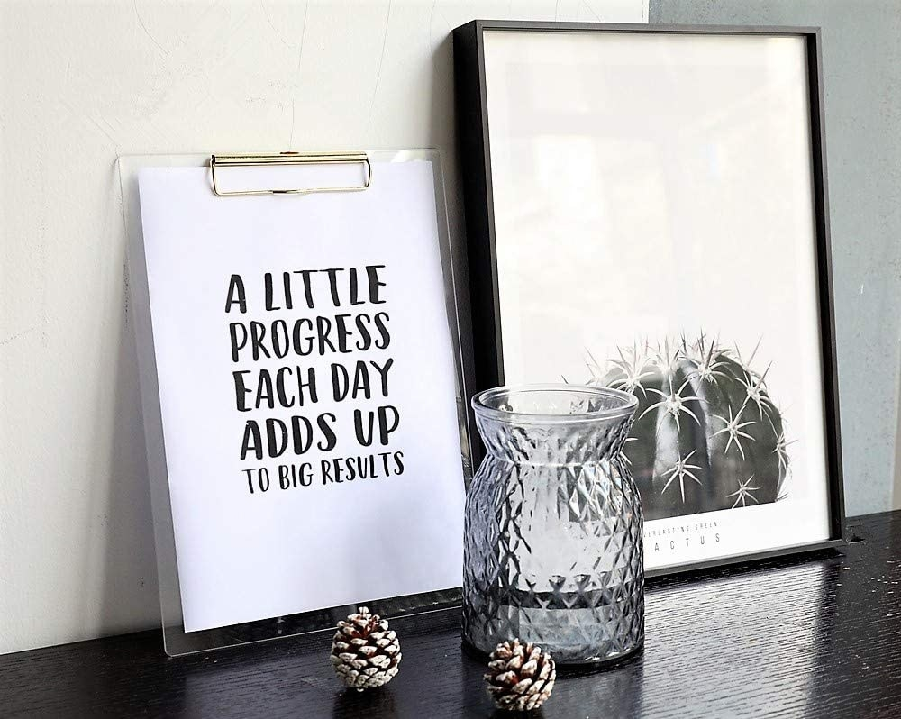 the clipboard with a piece of paper on it next to some home decor