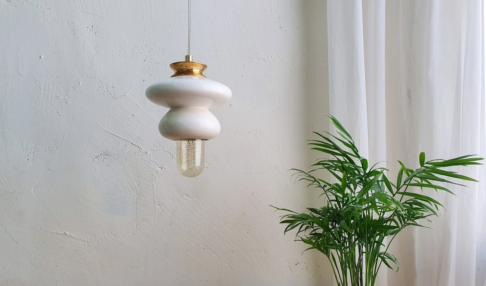 lamp hanging beside a plant