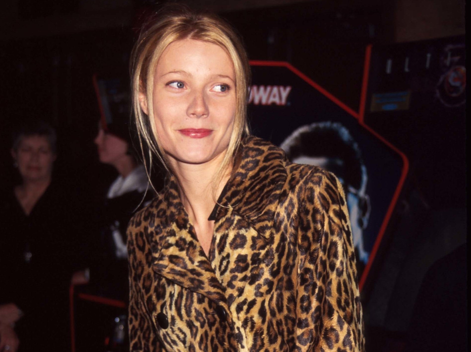 Gwyneth shyly looks away from the camera at an event in the early 2000s