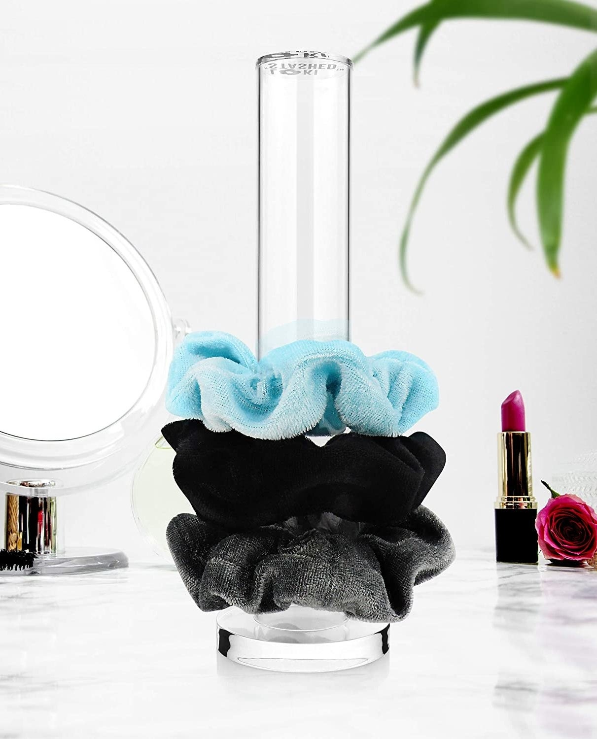 three scrunchies on the tower