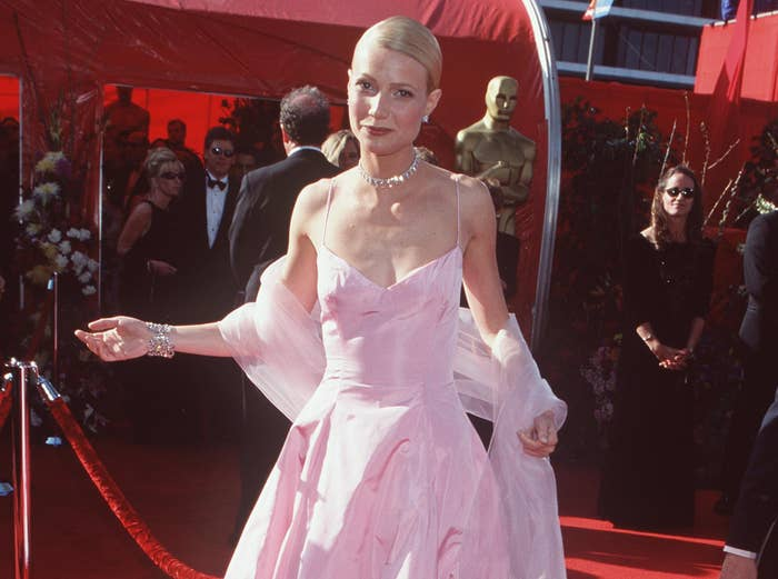 Gwyneth walks the red carpet at the Oscars in a pink dress