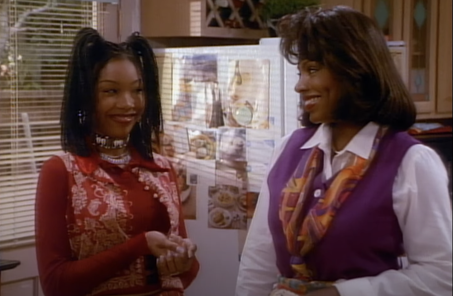 Moesha smiling sarcastically at her stepmother