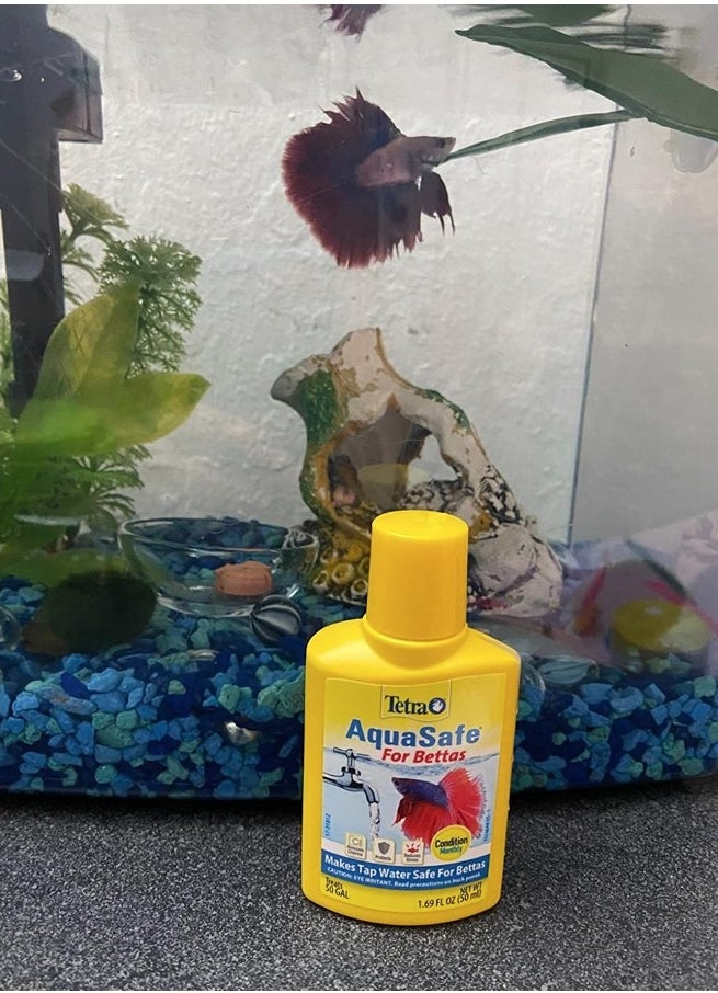 A reviewer betta tank with the water conditioner in front of it