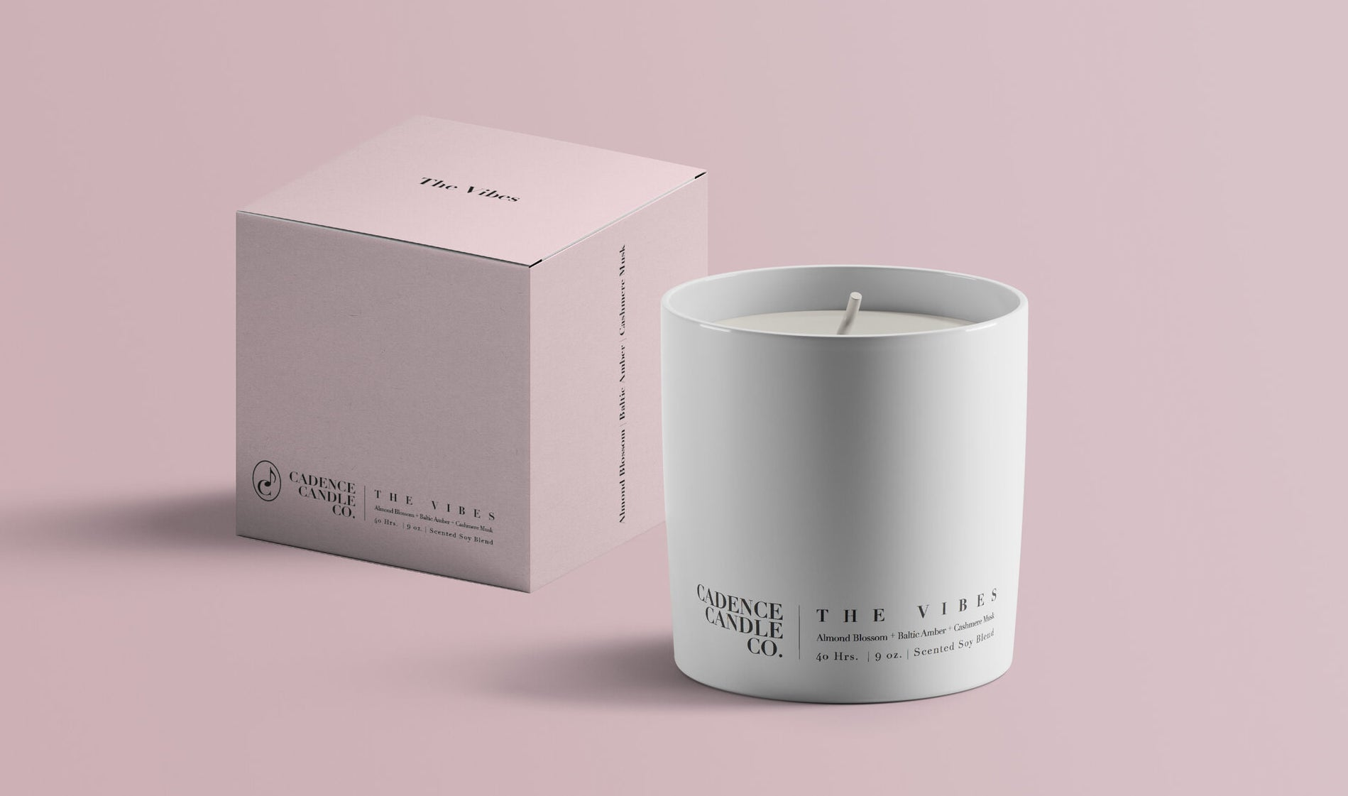"""a white candle that says """"the vibes"""" on it next to a pale blue box"""