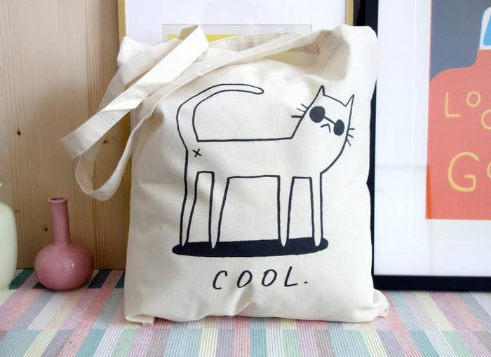 the cool cat shopping bag on a colorful rug