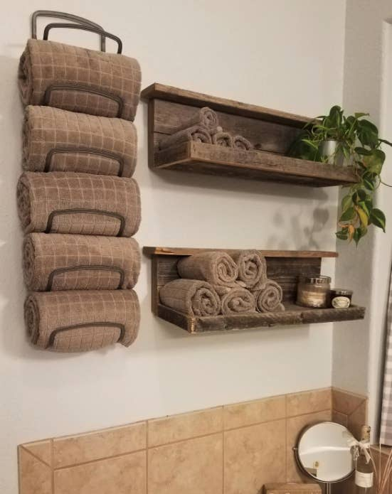 reviewer image of rack hung up holding five different towels