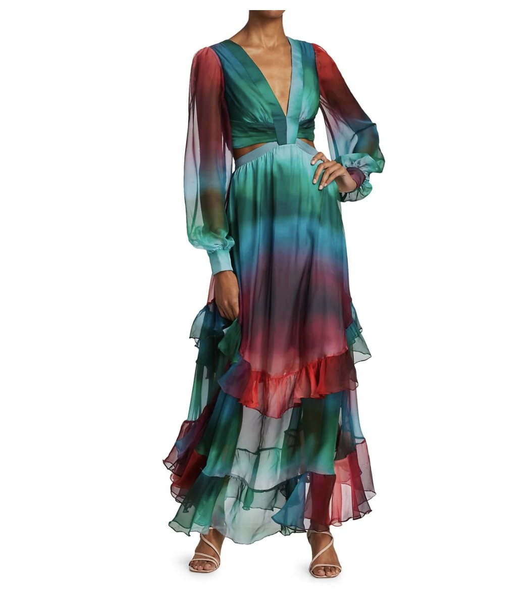 the dress with a sunset print on a model