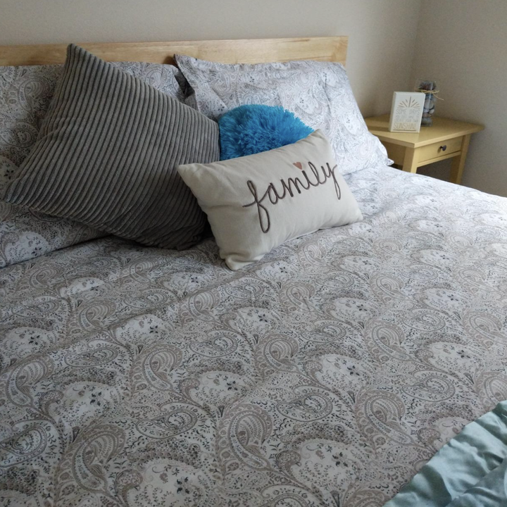 A customer review photo of their freshly made bed