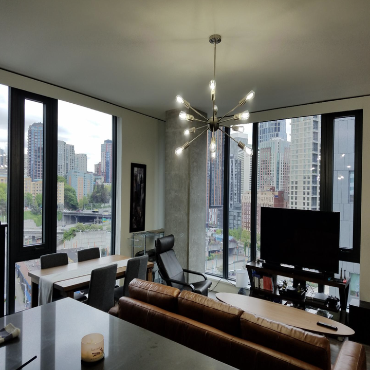 A customer review photo of the VINLUZ Sputnik Chandelier in Chrome hanging in their living room