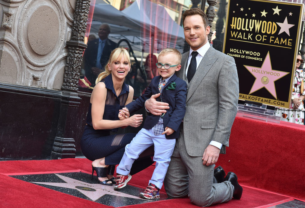 Anna and Chris posing with their son at the Hollywood Walk of Fame