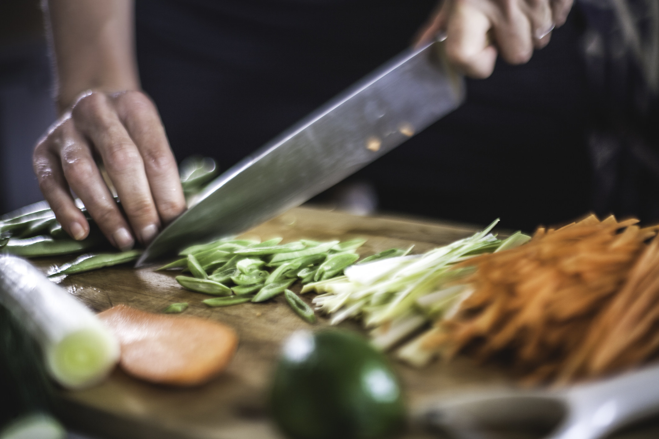 Julienning vegetables with a chef's knife.