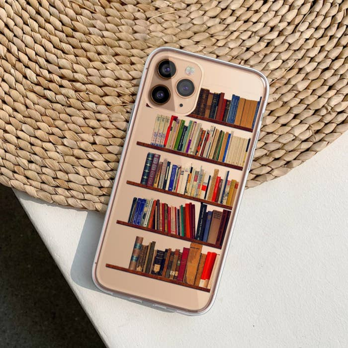 a phone case with bookshelves illustrated on it