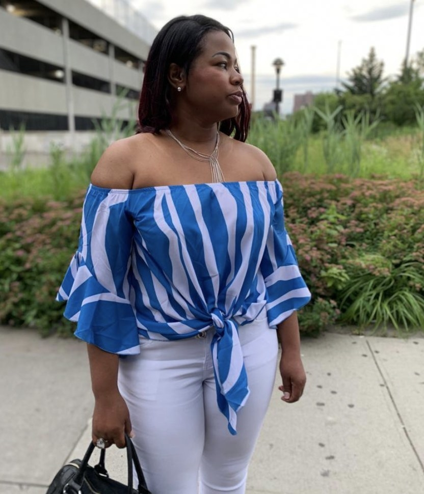 Person is wearing a blue and white striped top and white pants
