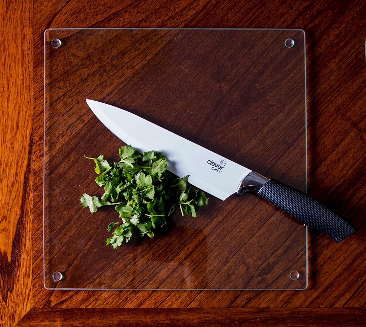 A glass cutting board on a countertop