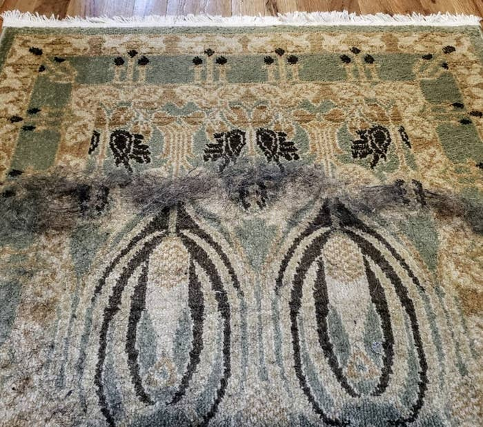 A rug with hair coming off it