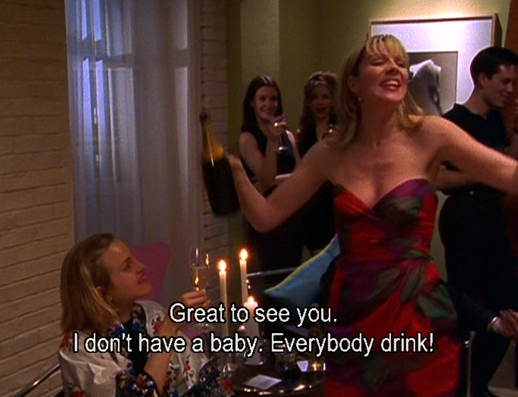 """Samantha from """"Sex and the City"""" pouring champagne at a party, saying: """"Great to see you. I don't have a baby. Everybody drink!"""""""