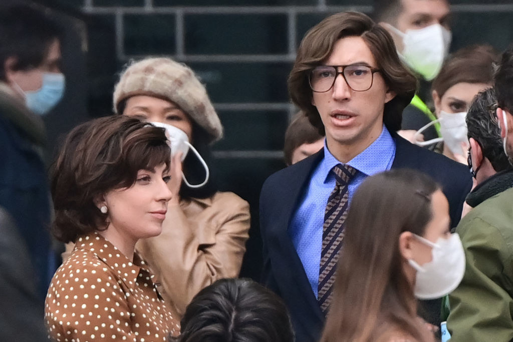 Lady Gaga and Adam Driver in a crowd of people