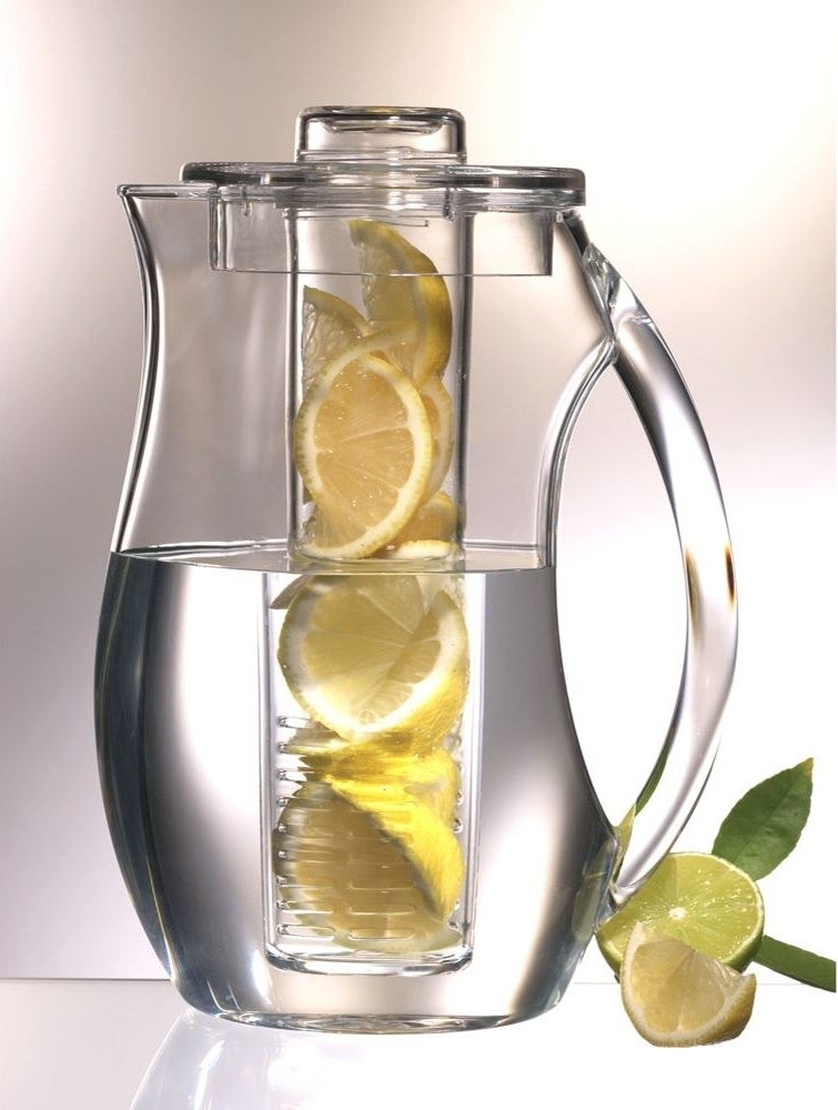 A water pitcher with lemons in it