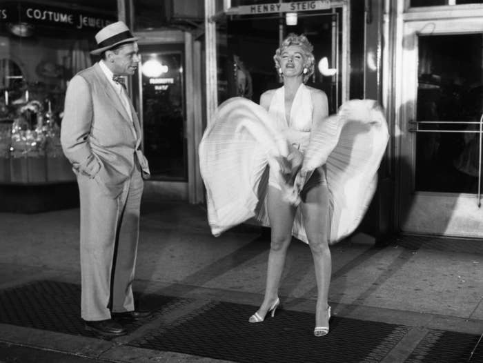 Marilyn stands over a subway grate and the wind from a passing train lifts her dress to her waist
